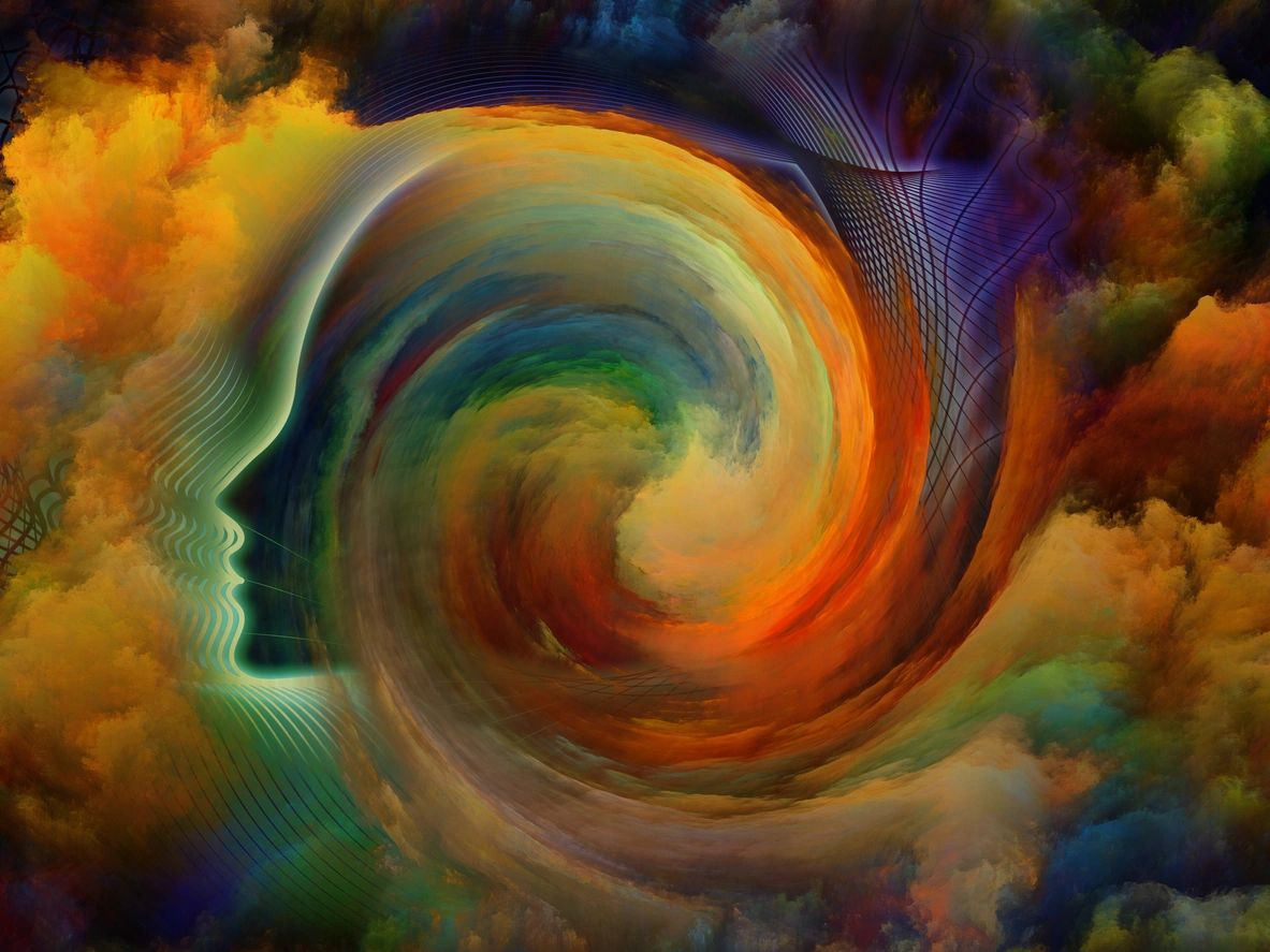 picture of head facing sideways, in the clous with a swilling clouk inside head of many different colors.