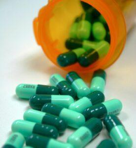 prescription drug bottle with pills spilling out